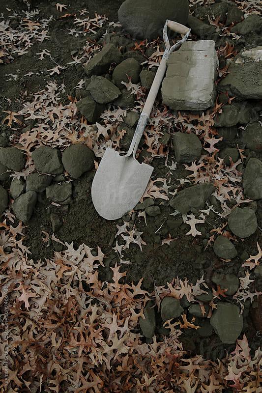 Shovel on Ground by Raymond Forbes LLC for Stocksy United
