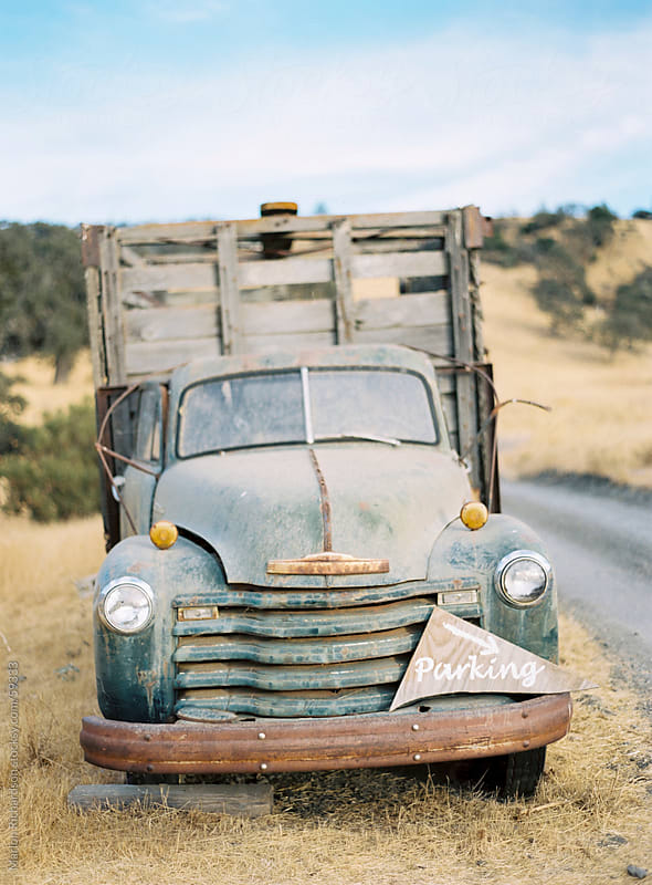 Rusty old truck near a dusty road by Marlon Richardson for Stocksy United