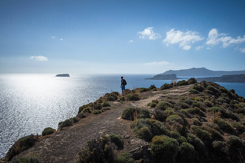 Man standing against majestic panorama in Santorini by GIC for Stocksy United