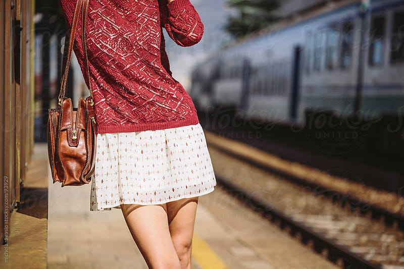 Young woman in a railway station by michela ravasio for Stocksy United