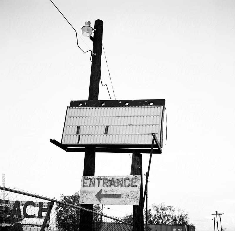 Empty Marquee and an Entrance Sign in Black and White by Briana Morrison for Stocksy United