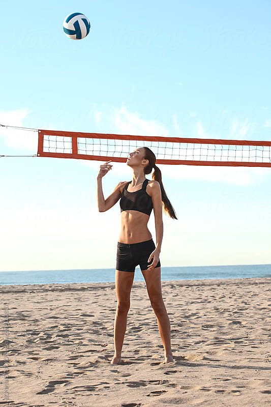 Beach volleyball. Sporty woman playing. by BONNINSTUDIO for Stocksy United