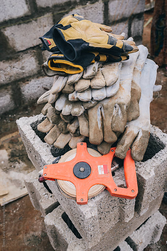Pile of dirty work gloves in Africa by Trent Lanz for Stocksy United