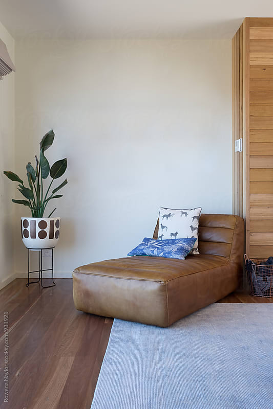 Leather chaise in lounge room by Rowena Naylor for Stocksy United