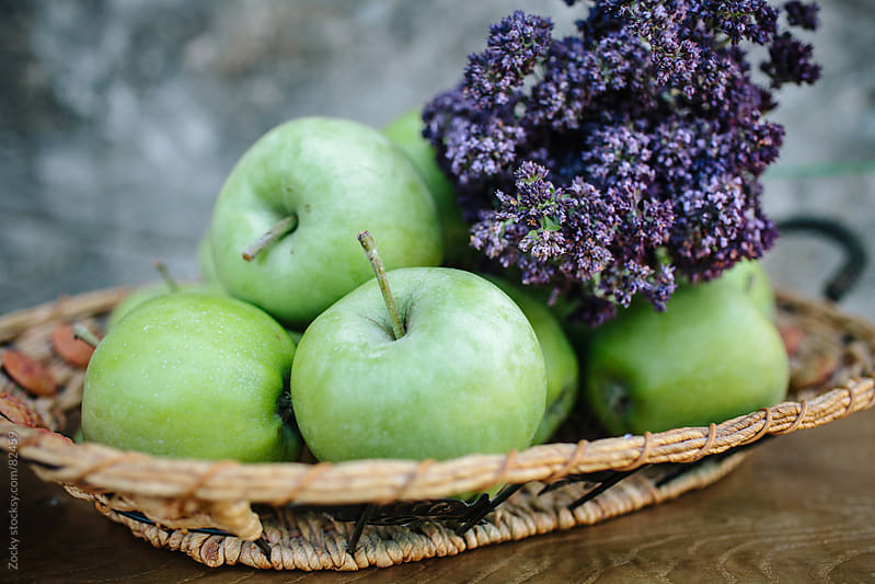 Basket with apples and herbs by Zocky for Stocksy United