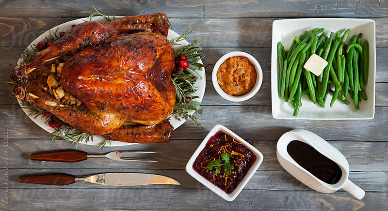 Thanksgiving: Tablescape of Delicious Thanksgiving Dinner Food by Sean Locke for Stocksy United