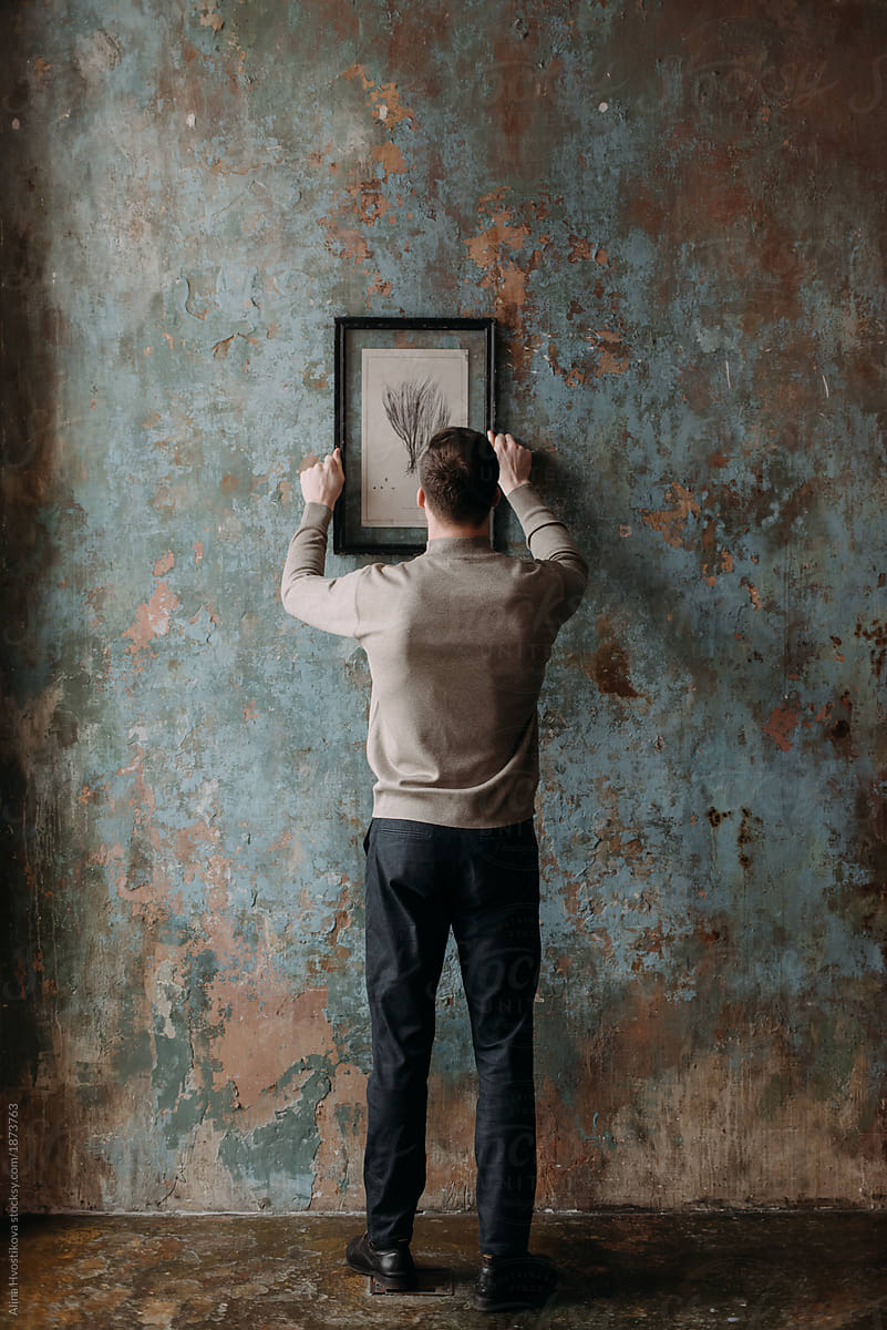 Stock Photo Man Hanging Painting On Wall