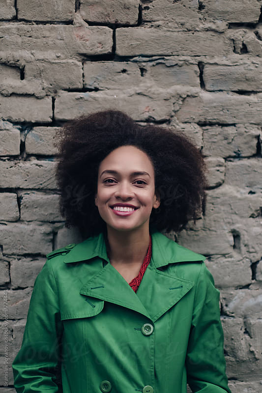 Portrait of a Beautiful Smiling Woman with Afro Hirstyle by Brkati Krokodil for Stocksy United