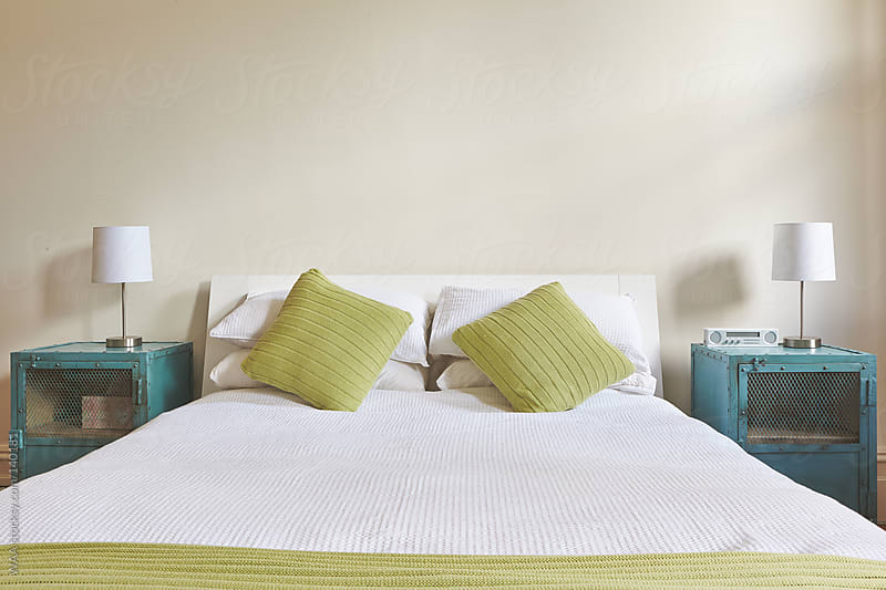 Bed and Side Tables in Light Filled Room by WAA for Stocksy United
