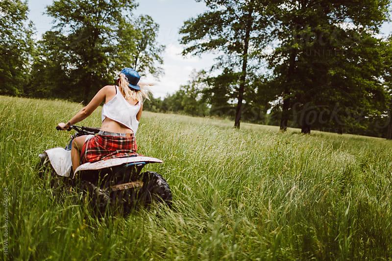 Rebellious girl rides on an ATV  by HOWL for Stocksy United