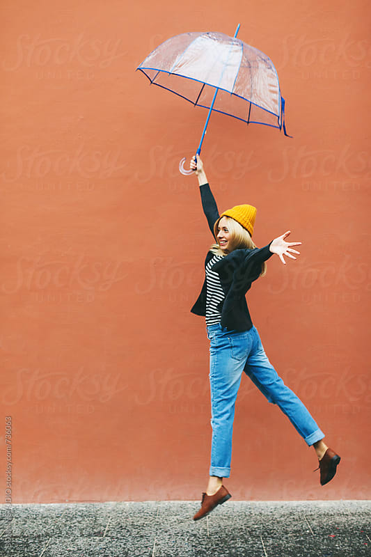 Woman enjoying in a rainy day. by BONNINSTUDIO for Stocksy United