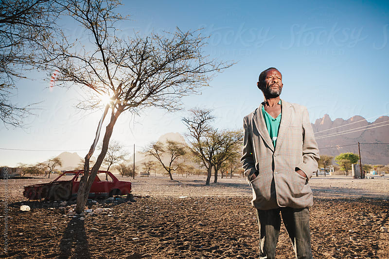 Portrait of an African Damara man at his home by Micky Wiswedel for Stocksy United