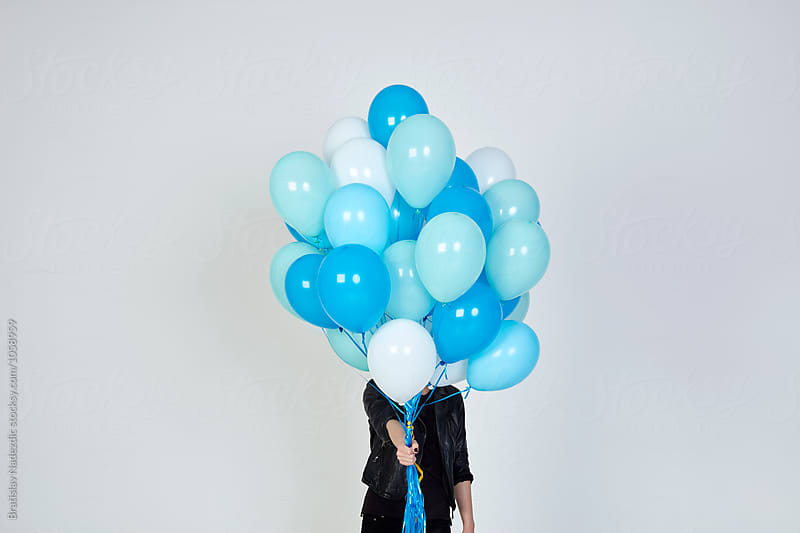 Young woman hold balloons by Bratislav Nadezdic for Stocksy United