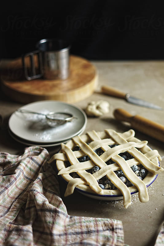 Making blueberry pie. by Darren Muir for Stocksy United