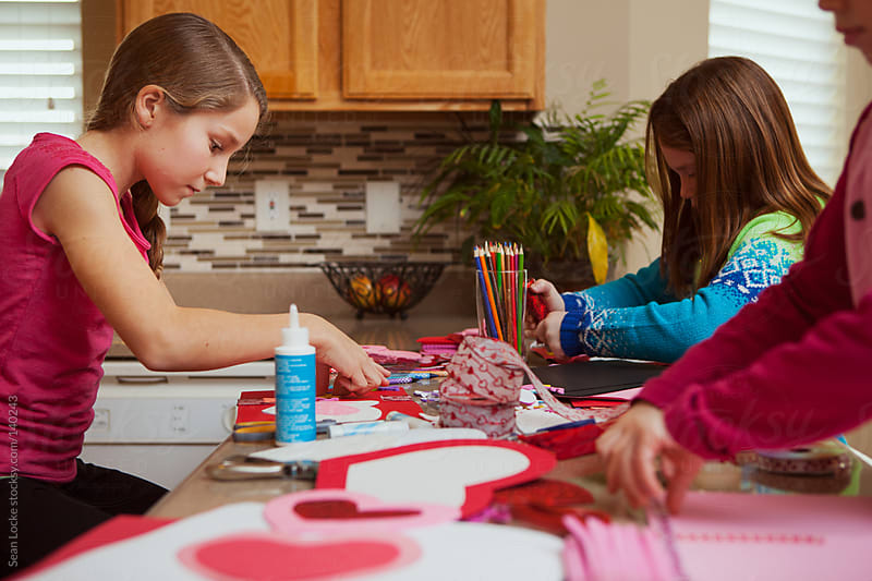 Valentine: Girls Making Holiday Crafts and Cards by Sean Locke for Stocksy United