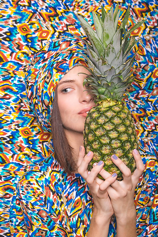Close-up of beautiful woman holding pineapple by Danil Nevsky for Stocksy United