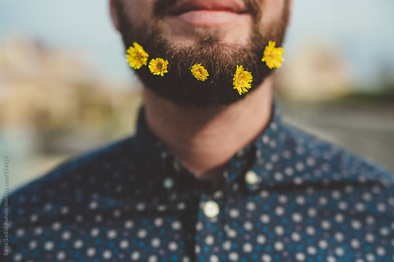 Cool beard with yellow flowers by Sanja (Lydia) Kulusic for Stocksy United