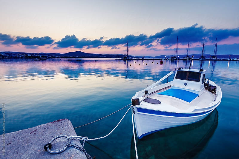 boats in a marina in milos island in greece at dawn by Helen Sotiriadis for Stocksy United