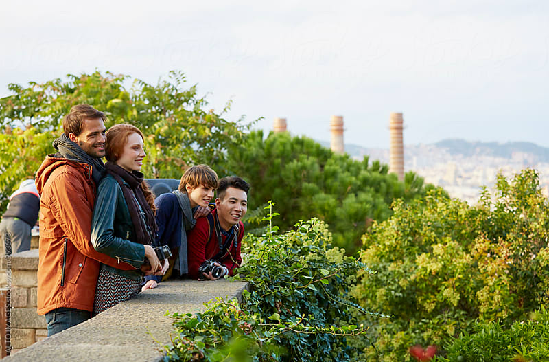 Happy Friends Looking At View From Observation Point by ALTO IMAGES for Stocksy United