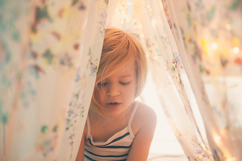 Girl Sitting on Her Bed With a Canopy by Lumina for Stocksy United
