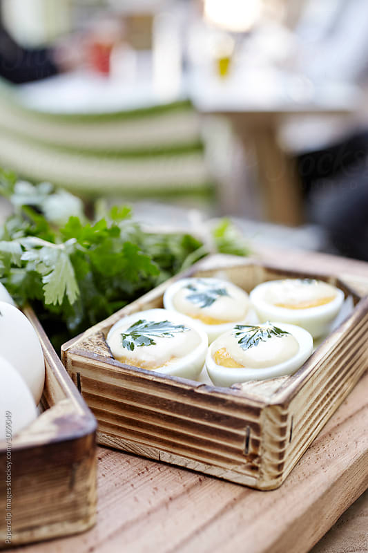 Hard Boiled Eggs with cheese and parsley by Paperclip Images for Stocksy United