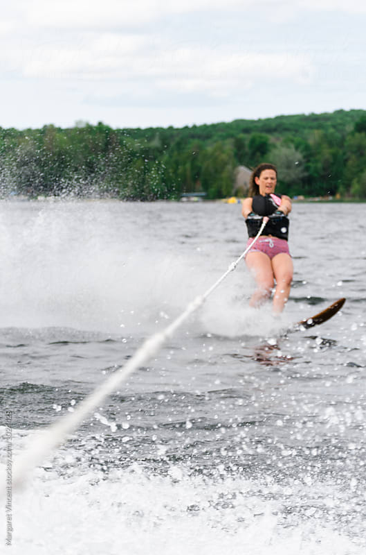 woman water skiing by Margaret Vincent for Stocksy United
