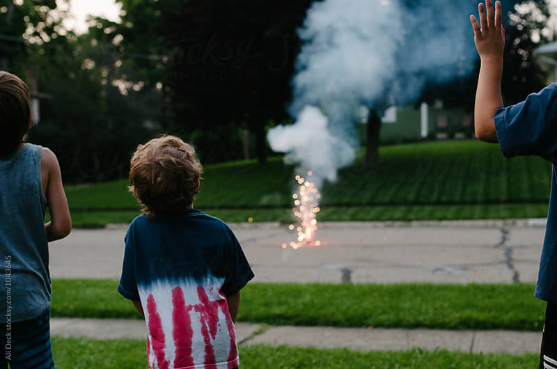 Boys and Fireworks by Ali Deck for Stocksy United