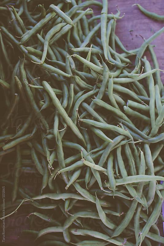 green beans at the farmer's market by Tara Romasanta for Stocksy United