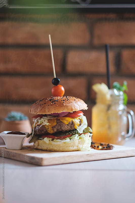 Beef Burger on the Wooden Board by Branislav Jovanović for Stocksy United