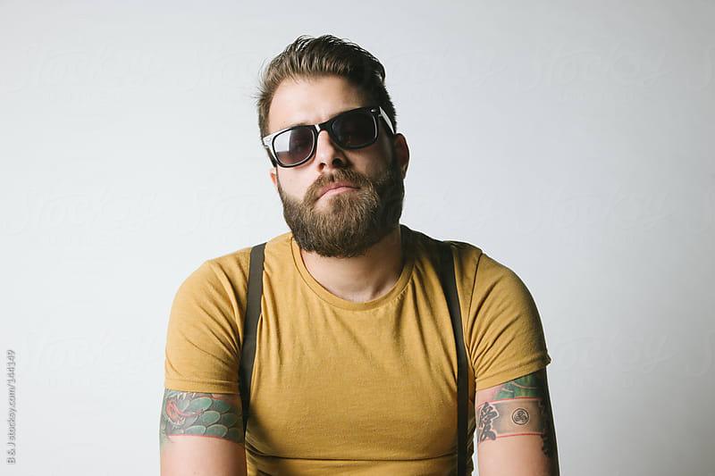 Urban bearded tattooed guy by B & J for Stocksy United