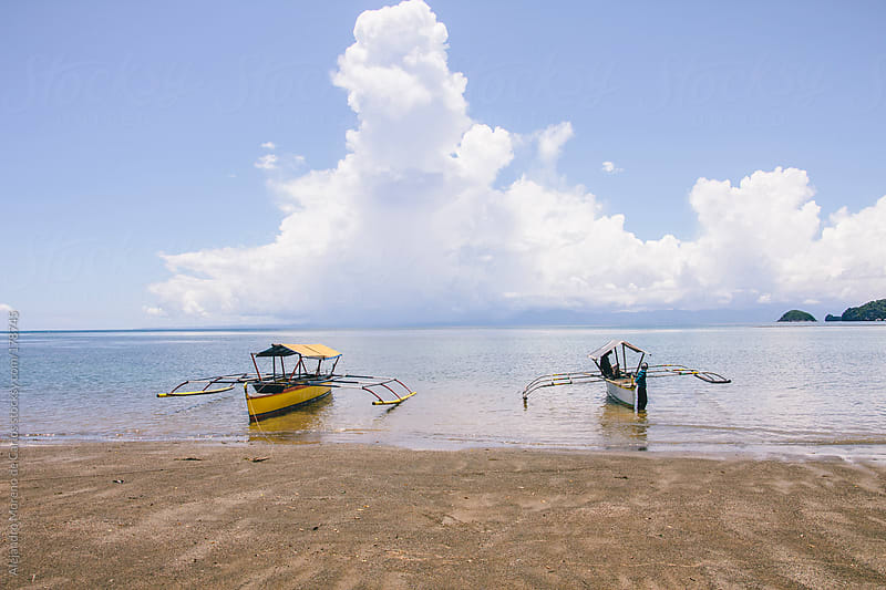 Traditional boats on the beach in Philippines by Alejandro Moreno de Carlos for Stocksy United