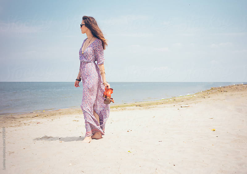 Woman Having a Walk on the Beach by Lumina for Stocksy United