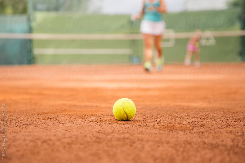 Tennis ball on the court by Danil Nevsky for Stocksy United