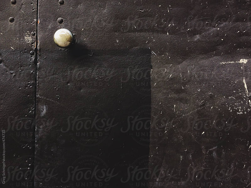 A gritty grungy black metal door texture by Greg Schmigel for Stocksy United