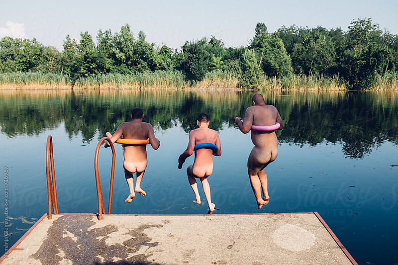Three Male Best Friends Jumping Nude Into the Lake by Nemanja Glumac for Stocksy United