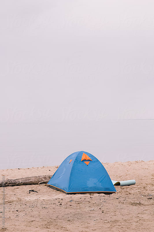 Lonely tent at the shoreside by Danil Nevsky for Stocksy United