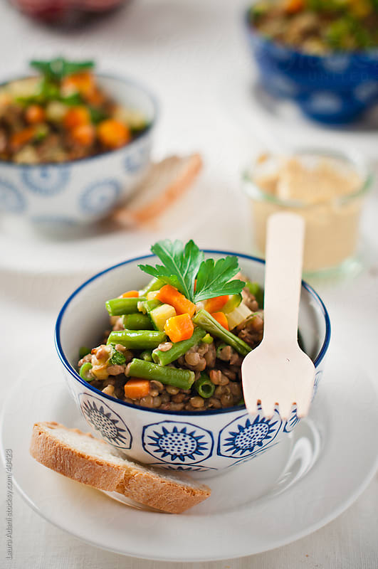 lentils salad with carrots and green beans by Laura Adani for Stocksy United