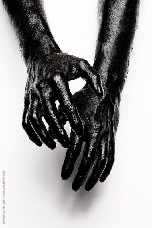 Abstract shot of human hands painted in black by Aleksandra Kovac for Stocksy United