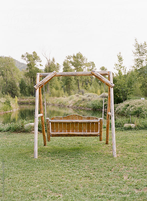 Outdoor wooden swing by Ali Harper for Stocksy United