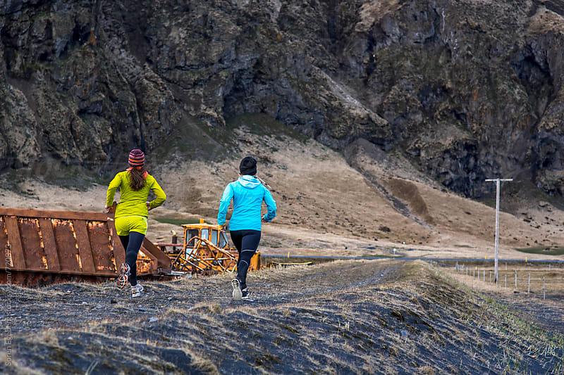 Two girls running  by Søren Egeberg Photography for Stocksy United