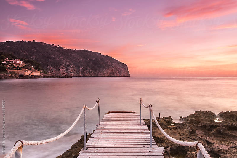 Mallorcan coast at sunset by Marilar Irastorza for Stocksy United