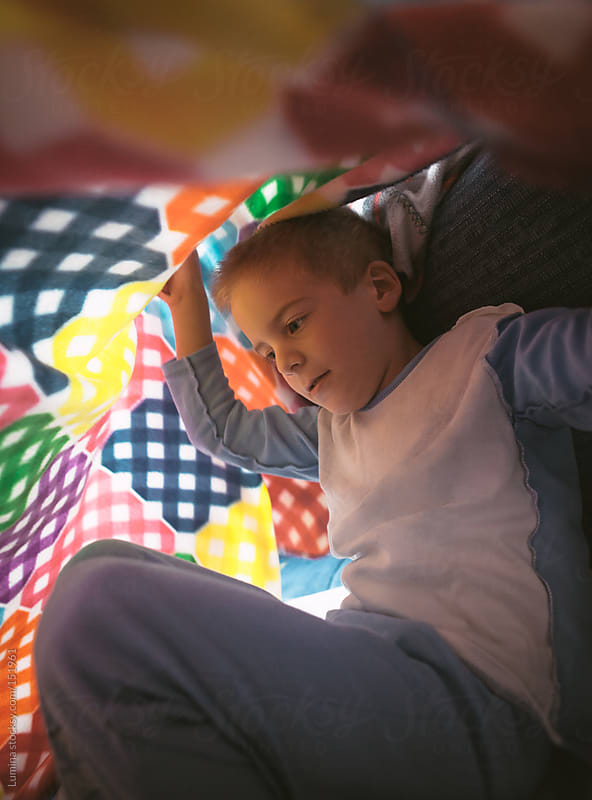 Boy Under the Blanket by Lumina for Stocksy United