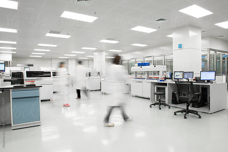 Scientists working in lab by MaaHoo Studio for Stocksy United