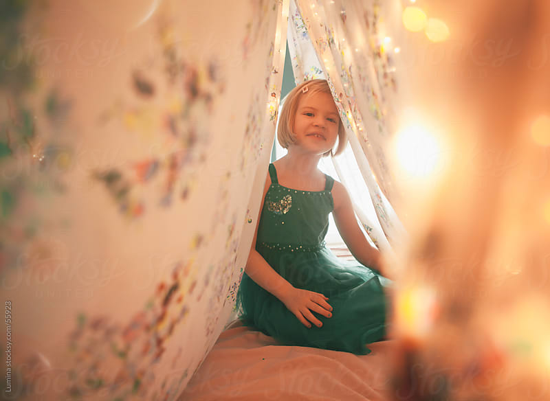 Girl Sitting on a Bed With a Canopy by Lumina for Stocksy United