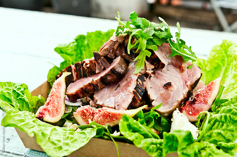 rare tuna salad with fresh fig by Gillian Vann for Stocksy United