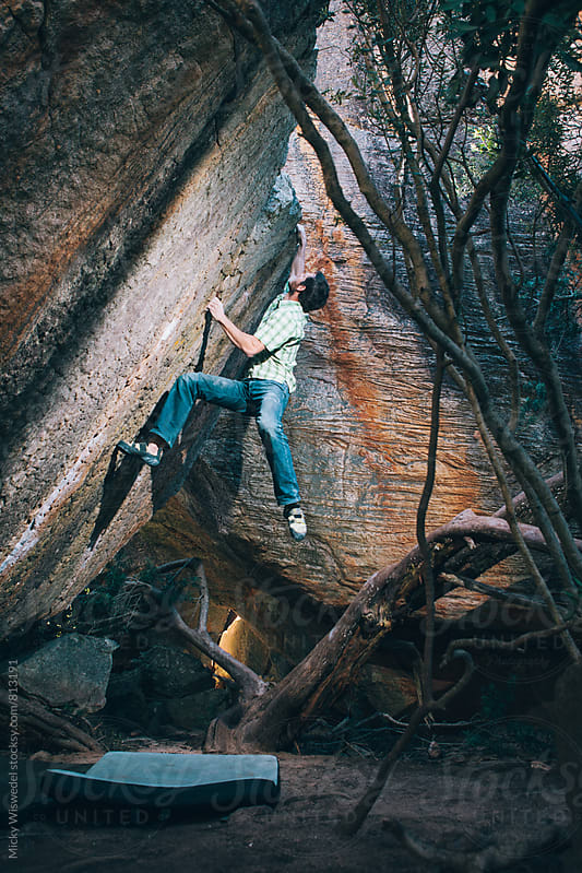 Climber bouldering on a boulder outdoors by Micky Wiswedel for Stocksy United