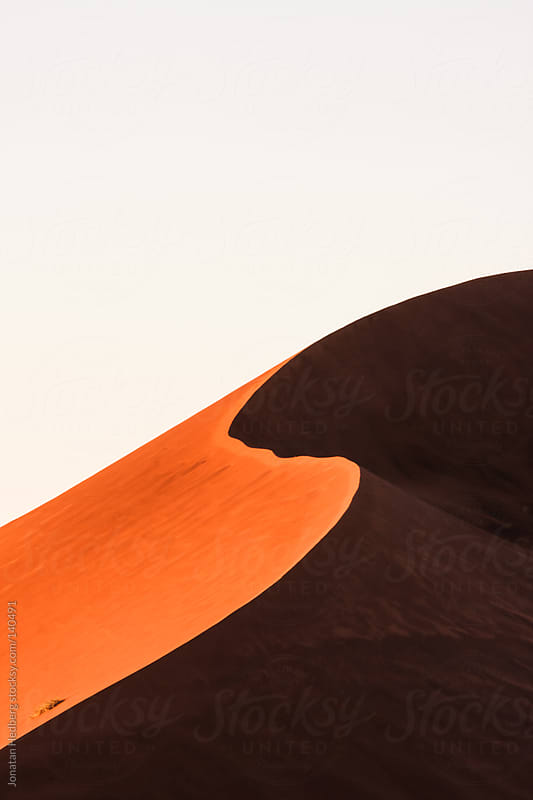 Red sand dunes at sunrise by Jonatan Hedberg for Stocksy United