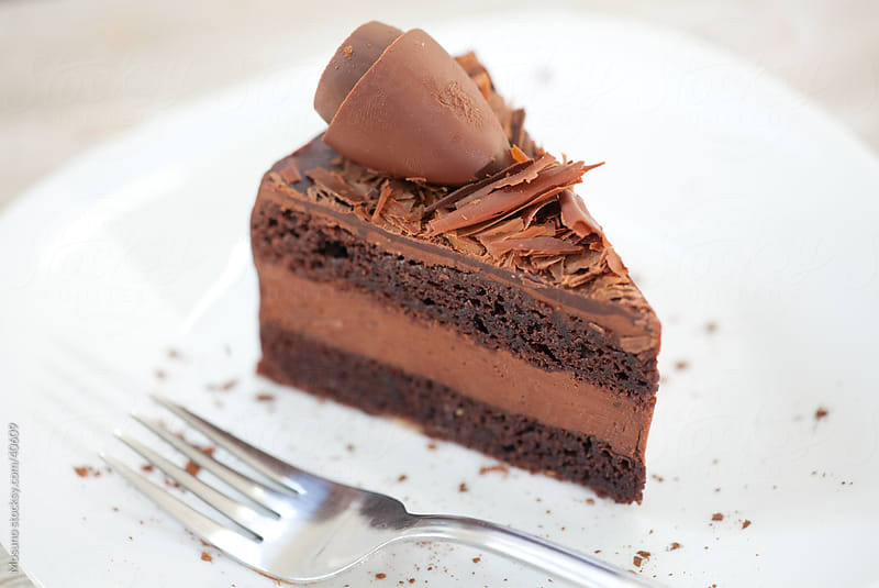 Deliciously looking piece of chocolate cake on a plate. by Mosuno for Stocksy United