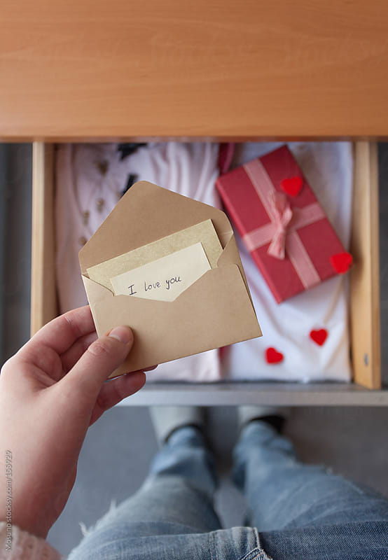 Woman Looking at the Gift and Love Letter in a Drawer by Mosuno for Stocksy United