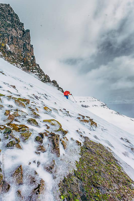 Female skier skiing downhill in Iceland by Søren Egeberg Photography for Stocksy United